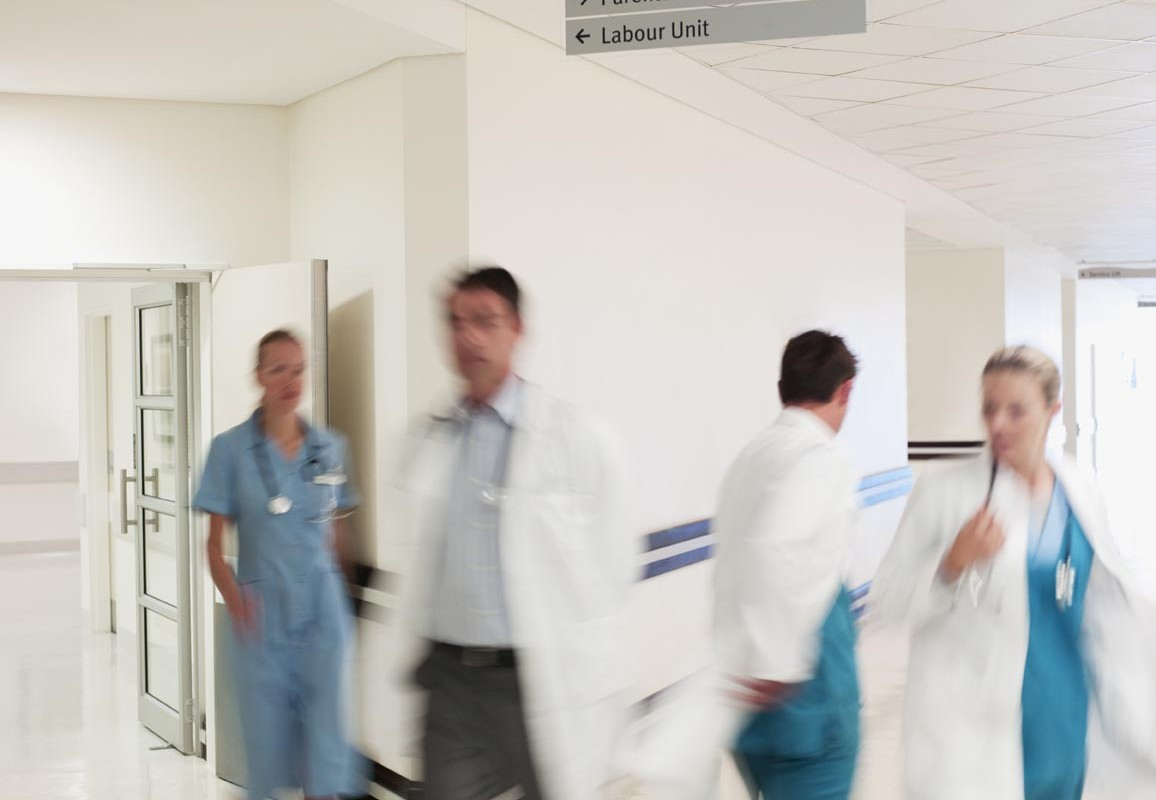 Mandatory Credit: Photo by OJO Images / Rex Features ( 1170041a ) MODEL RELEASED Doctors and nurses walking in hospital corridor VARIOUS